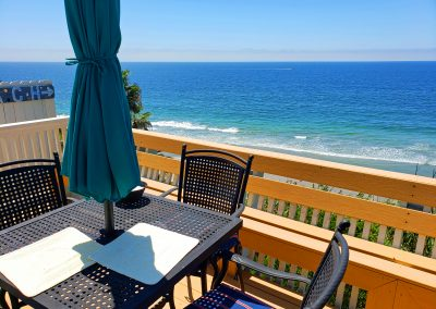 2 742 O Table Chairs over ocean